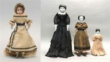 FOUR DOLLS 1) Circa 1900 wax-head doll with brown wig and blue eyes. ... Lot 383