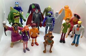 Scooby Doo characters with a Selection of Ghosts and Monsters