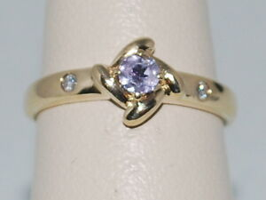 14k Yellow Gold Ring with a Solitaire Tanzanite and Diamonds