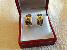 14k yellow gold (huggie) style earrings with emerald and diamond