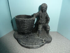VINTAGE CAST METAL / IRON MATCH HOLDER SEATED COLONIAL MAN W/ BASKET
