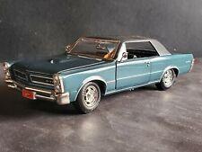 Johnny Lightning 1965 Pontiac GTO Blue w/Black Vinyl Top 1:24 Scale Diecast Car