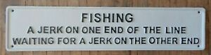 Cast iron sign FISHING A jerk on one end waiting for the jerk on the other Fun