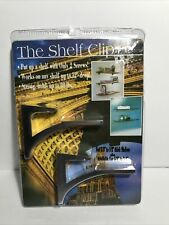 """The Shelf Clip for 3/8""""-1/2"""" thick, mounts shelf up to 12"""" deep with 2 screws"""