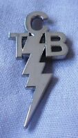 Elvis Presley Taking Care of Business TCB silver / nickel coloured pin badge.