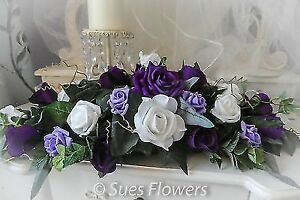 Table Centrepiece in Purple, Lilac and White Roses wedding flowers