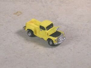N Scale 1951 Yellow Chevy Pickup with the hood up.