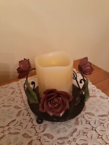 RUSTIC METAL PILLAR CANDLE HOLDER WITH METAL ROSE DECOR ACCENTS