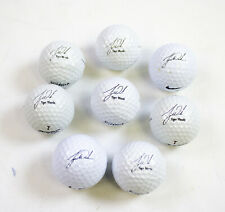 8 Assorted Unused Nike Tiger Woods Signature Golf Balls.