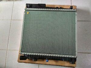 BMW E30 320i-325i radiator  !!NEW!!  GENUINE 17111707563