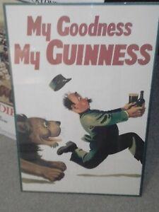 Framed Guinness advertising poster