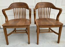 Two Vintage Solid Oak Milwaukee Chair Co. Banker Chairs