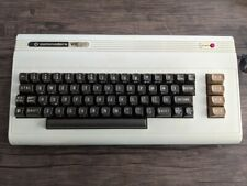 COMMODORE VIC-20 with four games, original box, and accessories