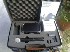A used Shure Pgx4/Pgx2 H6 Band Receiver/Handheld Wireless Mic. System in case.