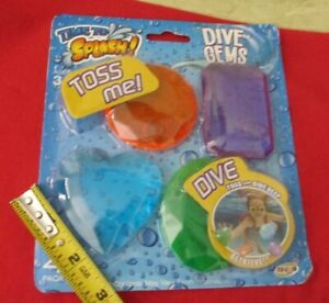dive gems sparkly pool toys diving treasures new in package purple heart neon