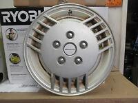 one 1986 1987 Pontiac Grand AM 14 inch hubcap wheel cover white