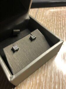 Diamond stud earings .66/tcw princess cut white gold