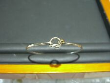 TIFFANY & CO WOMENS 18 KARAT YELLOW GOLD AND STERLING SILVER BRACELET BANGLE