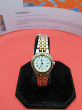 ladies accurist gold & silver tone bracelet watch,white face & gold hands.#112.