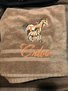 Machine embroidered towel, brown horse design!