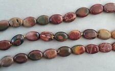 23 red creek jasper flat oval beads 15x10mm