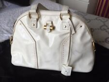 Vintage YSL Muse bag in off-white patent leather with brass detailing. Collector