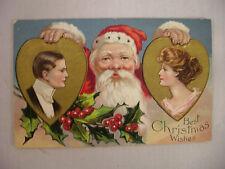 VINTAGE EMBOSSED CHRISTMAS POSTCARD SANTA HOLDING MAN & WOMAN HEART PORTRAITS