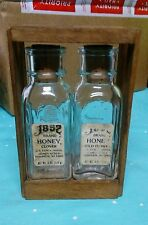 1852 Brand pure honey 2 four ounce bottles and wooden case.