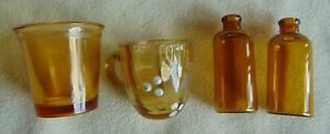 ANTIQUE AMBER GLASS COLLECTION: CHILD'S TOY CUP/HANDLE, CHILD'S CUP & 2 BOTTLES