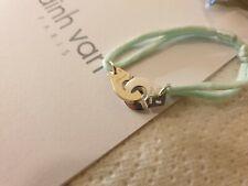 Bracelet Dinh Van Menottes R12 argent sur cordon