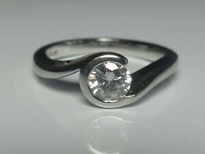 PLATINUM 0.25CT G VS DIAMOND SOLITAIRE CROSSOVER RING