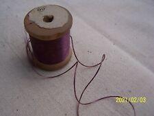 Mercerie ancienne. Ancienne bobine de fil de soie couleur vieux rose. N°7
