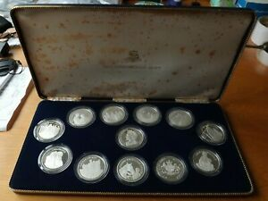 12 x British Queen Mother Sterling Silver Medallions 1980 Proof Grade Cased.