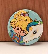 "Twenty Four (24) Rainbow Brite 1 1/2"" Pinback Buttons by Hallmark."