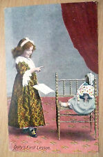 POSTCARD- DOLLY'S FIRST LESSON (VG*)