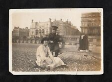c1920s Original Photo - Soldier sitting on a bench on beach with his wife