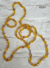 LONG YELLOW TONES PLASTIC FACETED BEADED NECKLACE