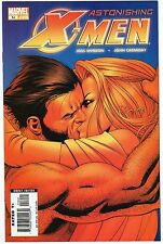 Astonishing X-men 14 NM- condition Wolverine, Emma Frost Kissing Cover!