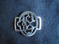 ancienne boucle monogrammée de porte jarretelle en argent XIX ème