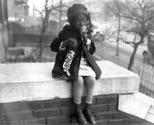 Photo. 1922. African American Girl Eating Ice Cream in Winter
