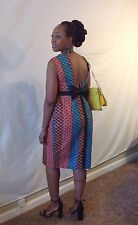 African woman dress with bow tie at the back and visible zipper size 8,10,12