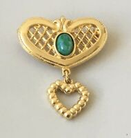 Vintage   heart brooch in gold tone metal