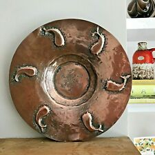 Arts & Crafts hammered copper dish, stylised whale motifs in the Newlyn style