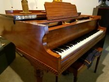 Used Baby Grand Piano, wood finish, 5' made by Currier-Kimball; hard wood finish