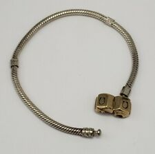 CHAMILIA STERLING SILVER AND 14K GOLD CHARMS BRACELET