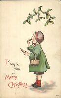 Christmas - Girl in Bonnet w/ Basket - Eating Bread c1910 Postcard