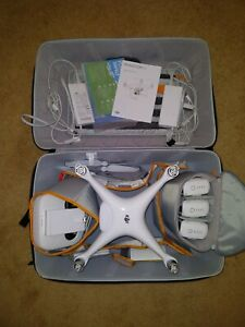 DJI Phantom 4 WITH EXTRAS! 4 batteries, 2 chargers ND filters, case and more!