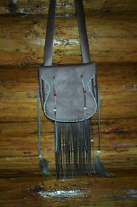 BLACK POWDER, BEAVER TAIL, LEATHER POSSIBLE BAG