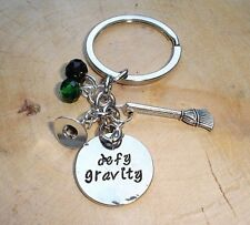 WICKED THE MUSICAL DEFY GRAVITY KEYRING KEYCHAIN CHARMS WIZARD OF OZ IN GIFT BAG