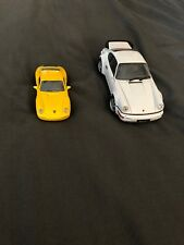 Two Porsche Toy Cars